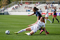 CARY, NC - APRIL 10: Merritt Mathias #11 of the NC Courage tackles the ball away from Ashley Hatch #33 of the Washington Spirit during a game between Washington Spirit and North Carolina Courage at Sahlen's Stadium at WakeMed Soccer Park on April 10, 2021 in Cary, North Carolina.