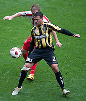 MELBOURNE, AUSTRALIA - SEPTEMBER 19, 2010: Manny Muscat from the Phoenix protects the ball in Round 7 of the 2010 A-League between the Melbourne Heart and Wellington Phoenix at AAMI Park on September 19, 2010 in Melbourne, Australia. (Photo by Sydney Low / Asterisk Images)