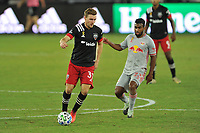 WASHINGTON, DC - SEPTEMBER 12: Julian Gressel #31 of D.C. United battles for the ball with Cristian Casseres Jr. #23 of New York Red Bulls during a game between New York Red Bulls and D.C. United at Audi Field on September 12, 2020 in Washington, DC.