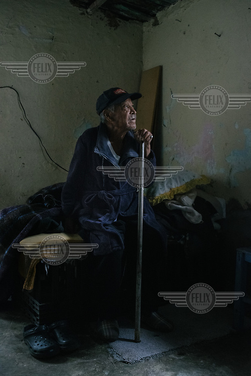 Emiliano Carmona rests in his living room. He was soon to die due to a prostate cancer that had seen him weaken for months. He refused to go to hospital as he did not wish to die away from his family's land.