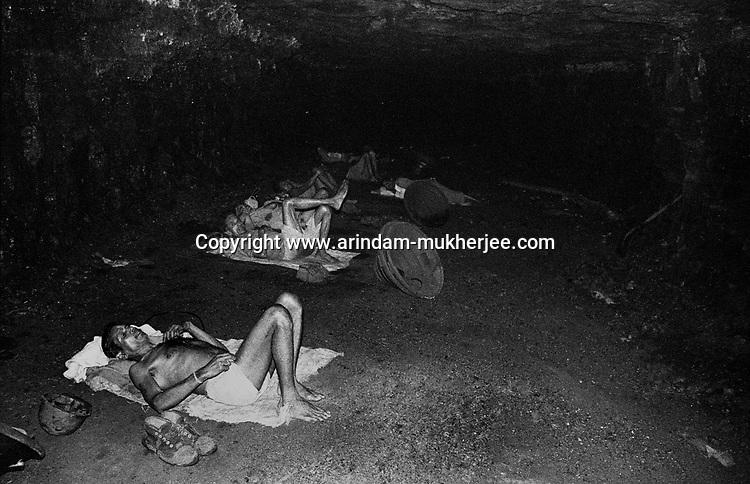 Miners resting inside an undernground mine during a break, North Searsole Coliery in Ranigunj, West Bengal, India. Arindam Mukherjee
