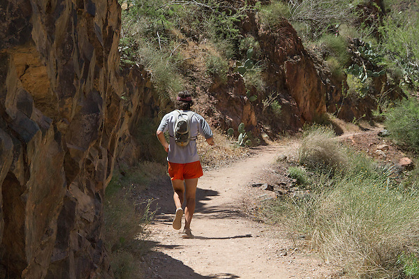 Male trail runner in Grand Canyon National Park, northern Arizona. . John offers private photo tours in Grand Canyon National Park and throughout Arizona, Utah and Colorado. Year-round.