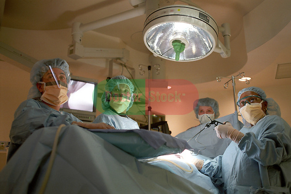 Orthopedic surgery with surgeon and staff