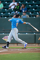 Ian Happ (5) of the Myrtle Beach Pelicans follows through on the first of two home runs on the night against the Winston-Salem Dash at BB&T Ballpark on April 18, 2016 in Winston-Salem, North Carolina.  The Pelicans defeated the Dash 6-4.  (Brian Westerholt/Four Seam Images)