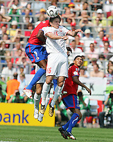 Arkadiusz Radomski (16) of Poland heads before Paulo Wanchope (9) of Costa Rica. Poland defeated Costa Rica 2-1 in their FIFA World Cup Group A match at FIFA World Cup Stadium, Hanover, Germany, June 20, 2006.