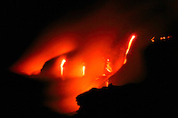Creation of new land: Hydromagnetic explosions occur when molten lava flows into ocean, Hawai'i Volcanoes National Park at night, Kilauea, Big Island.