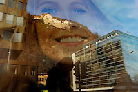 Vaduz castle, home to Liechtenstein's royal family, is reflected in a window behind the smiling face of a woman on an advertising billboard. The ruling royal family control the country's largest bank and have the power to veto laws, dissolve parliament and appoint judges. Liechtenstein has become a major tax haven, whose opaque banking laws are said to aid fraud, money laundering and tax evasion. There are an estimated 75,000 companies registered in the country, twice that of the population. .