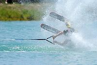 A waterskier preforms a flip.