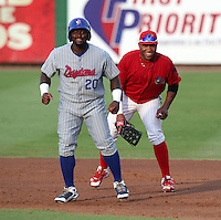 Clearwater Threshers Jonathan Singleton #3 and Michael Burgess #20 during a game against the Daytona Cubs at Brighthouse Stadium on June 23, 2011 in Clearwater, Florida.  Clearwater defeated Daytona 6-5.  (Mike Janes/Four Seam Images)