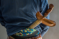 Yogyakarta, Java, Indonesia.  Sultan's Palace Guard with Kris (Traditional Javanese Dagger) Tucked into Waistband.  The sultan's emblem is on the upper part of the scabbard.