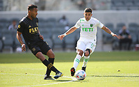 LOS ANGELES, CA - APRIL 17: Eddie Segura #4 of LAFC and Rodney Redes #11 of Austin FC meet during a game between Austin FC and Los Angeles FC at Banc of California Stadium on April 17, 2021 in Los Angeles, California.