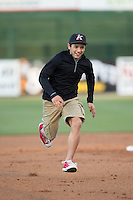 A young fan out runs Kannapolis Intimidators mascot Tim E. Gator (not shown) between innings of the game against the Hickory Crawdads at Kannapolis Intimidators Stadium on April 7, 2016 in Kannapolis, North Carolina.  The Crawdads defeated the Intimidators 5-1.  (Brian Westerholt/Four Seam Images)