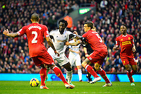 Sunday, 23 February 2014<br /> Pictured: Swansea City's Wilfried Bony is challenged by Liverpool's Daniel Agger<br /> Re: Barclay's Premier League, Liverpool FC v Swansea City FC v at Anfield Stadium, Liverpool Merseyside, UK.