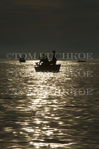 Sunset with fishermen on Lake Michigan, near Frankfort Michigan.