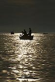 Sunset with fishermen on Lake Michigan, near Frankfort Michigan.