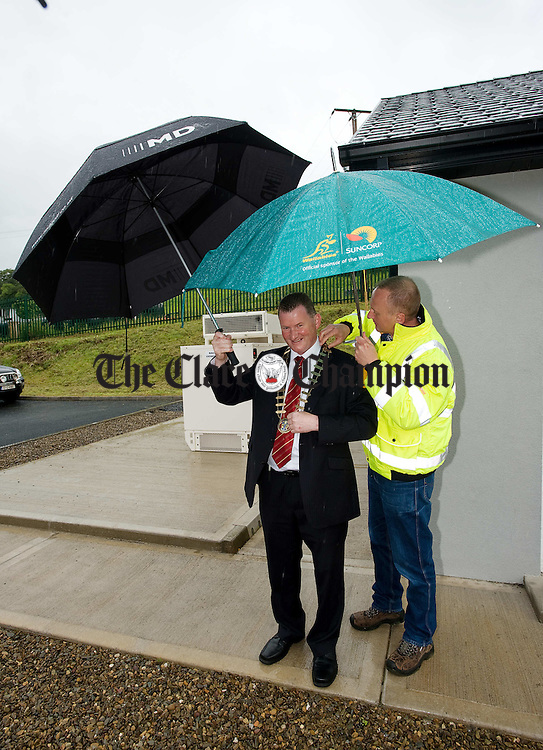 Mayor of Clare Pat Hayes gets some help with his Mayoral chain from John Teteris, HQA of Coffey Water Ltd. at the official opening of the Feakle Sewerage scheme. Photograph by John Kelly.