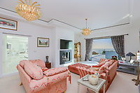 BNPS.co.uk (01202 558833)<br /> Pic: KnightFrank/BNPS<br /> <br /> A bit of all white...<br /> <br /> Yours for 3 million pounds - Mediterranean style views...from a seaside home in Torquay.<br /> <br /> This modern and contemporary property is in one of the most exclusive areas of Torquay in Devon and has spectacular views of Tor Bay.<br /> <br /> In the foreground in the rocky outcrop known as Thatcher's Rock.<br /> <br /> But the coastal landmark isn't named after the late Tory Prime Minister but the fact that from certain angles the rock formation looks like a thatcher working on a roof.