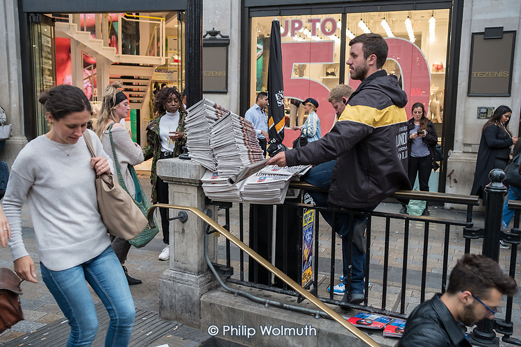 Evening Standard newspaper seller, Oxford Circus, London.