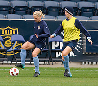 USWNT midfielder Lindsay Tarpley tries to keep the ball away from teammate Megan Rapinoe during practice at PPL Park in Chester, PA.