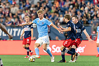 FOXBOROUGH, MA - SEPTEMBER 11: Keaton Parks #55 of New York City FC dribbles as Scott Caldwell #6 of New England Revolution defends during a game between New York City FC and New England Revolution at Gillette Stadium on September 11, 2021 in Foxborough, Massachusetts.