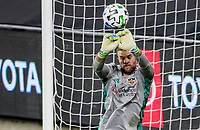 CARSON, CA - OCTOBER 28: Marko Maric  #1 of the Houston Dynamo blocks an incoming ball during a game between Houston Dynamo and Los Angeles FC at Banc of California Stadium on October 28, 2020 in Carson, California.