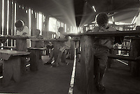 Rural school in charcoal works at Ribas do Rio Pardo rual area, Mato Grosso do Sul State, mid-west Brazil. Lucky children who have available hours in the charcoal production line attend an improvised school no more than two hours a day, two days a week. Because there is only one teacher, pupils of different grades share the same class. When it rains, classes are called off  because water gets in the room all over the place. No electrical light.