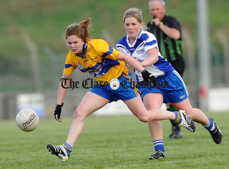 The Banner's Louise Woods is tackled by Deirdre Troy of West Clare Gaels  during the Ladies Football Division 1 final at Quilty. Photograph by John Kelly.