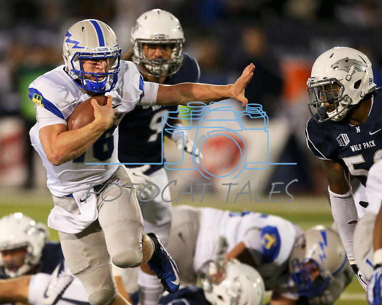 Air Force's Karson Roberts (16) runs through the Nevada defense during the second half of an NCAA football game in Reno, Nev., on Saturday, Sept. 28, 2013. (AP Photo/Cathleen Allison)