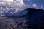 Teahupoo, Tahiti. May 2000. A boogie boarder  gets tubed at Teahupoo.