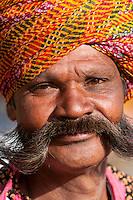 Jaipur, Rajasthan, India.  Portrait of a Trumpet Player at the City Palace prior to a Wedding Reception.