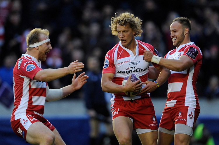 Billy Twelvetrees of Gloucester Rugby celebrates scoring the first try of the match with team mates Matt Kvesic and Bill Meakes of Gloucester Rugby