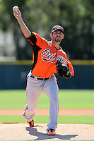 Baltimore Orioles pitcher Jake Arrieta #34 delivers a pitch during a minor league spring training game against the Minnesota Twins at the Buck O'Neil Complex on March 19, 2012 in Sarasota, Florida.  (Mike Janes/Four Seam Images)