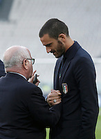 Italy's Leonardo Bonucci, right, talks to Italian Soccer Federation (FIGC) president Carlo Tavecchio during the walk around the pitch of the Juventus Stadium, ahead of the FIFA World Cup 2018 qualification match against Spain, in Turin, 5 October 2016.<br /> <br /> <br /> UPDATE IMAGES PRESS/Isabella Bonotto