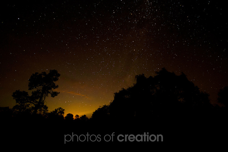 Night shot of moon rise over Mungo National Park NSW showing the Southern Cross
