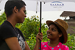 Fishing Cat (Prionailurus viverrinus) biologist, Anya Ratnayaka, speaking to fishing cat enthusiast, Urban Fishing Cat Project, Diyasaru Park, Colombo, Sri Lanka