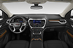 Stock photo of straight dashboard view of 2020 GMC Acadia SLE 5 Door SUV Dashboard