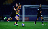 Lincoln City's Conor McGrandles vies for possession with Mansfield Town's Jordan Bowery<br /> <br /> Photographer Andrew Vaughan/CameraSport<br /> <br /> EFL Trophy Northern Section Group E - Mansfield Town v Lincoln City - Tuesday 6th October 2020 - Field Mill - Mansfield  <br />  <br /> World Copyright © 2020 CameraSport. All rights reserved. 43 Linden Ave. Countesthorpe. Leicester. England. LE8 5PG - Tel: +44 (0) 116 277 4147 - admin@camerasport.com - www.camerasport.com