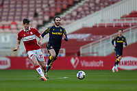 13th March 2021; Riverside Stadium, Middlesbrough, Cleveland, England; English Football League Championship Football, Middlesbrough versus Stoke City; Paddy McNair of Middlesbrough passes the ball back to his goalkeeper under pressure from Nick Powell of Stoke City