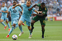 ST PAUL, MN - JULY 24: Brent Kallman #14 of Minnesota United FC and Dairon Asprilla #27 of the Portland Timbers battle for the ball during a game between Portland Timbers and Minnesota United FC at Allianz Field on July 24, 2021 in St Paul, Minnesota.