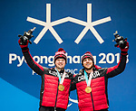 Mac Marcoux and Jack Leitch, PyeongChang 2018 - Para Alpine Skiing // Ski para-alpin.<br /> Mac Marcoux and his guide Jack Leitch collect their gold medals in the men's visually impaired downhill during the medal ceremony at the PyeongChang Olympic Plaza // Mac Marcoux et son guide Jack Leitch reçoivent leurs médailles d'or en ski alpin avec une déficience visuelle à la place olympique de PyeongChang. 10/03/2018.