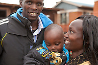 2011 London Marathon winner Mary Keitany with her child Jared and husband Charles Koech at their home in Iten, Kenya.