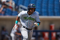 Jorge Burgos (32) of the Lynchburg Hillcats hustles down the first base line against the Kannapolis Cannon Ballers at Atrium Health Ballpark on August 29, 2021 in Kannapolis, North Carolina. (Brian Westerholt/Four Seam Images)