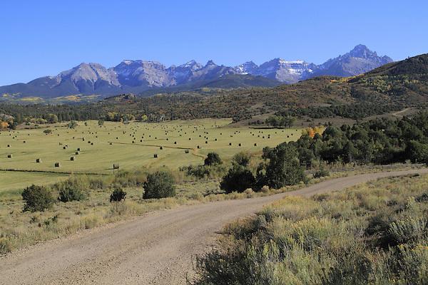 Mount Sneffels (right) in the San Juan Mountains, Mountains, near Ridgeway, Colorado. John offers autumn photo tours throughout Colorado.