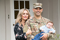 Military family at home with newborn baby and son.  Model-released and US DoD-compliant for advertising and promotional use