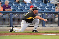 Bradenton Marauders manager Tom Prince (14) tells the runner where to slide during a game against the Charlotte Stone Crabs on April 4, 2014 at Charlotte Sports Park in Port Charlotte, Florida.  Bradenton defeated Charlotte 9-1.  (Mike Janes/Four Seam Images)