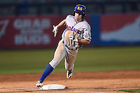 Midland RockHounds outfielder Billy Burns (17) runs the bases during a game against the Tulsa Drillers on May 31, 2014 at ONEOK Field in Tulsa, Oklahoma.  Tulsa defeated Midland 5-3.  (Mike Janes/Four Seam Images)
