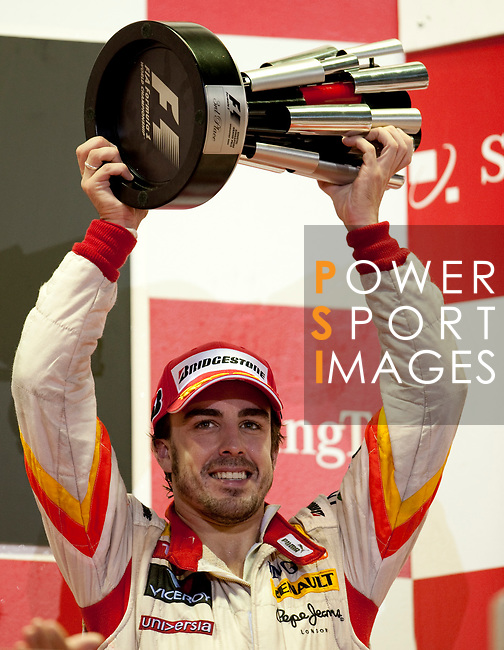 27 Sept 2009, Singapore --- ING Renault F1 Team driver Fernando Alonso of Spain celebrates on the podium after finishing third on the Fia Formula One 2009 Singtel Singapore Grand Prix, the world's only street night race, at the Marina Bay street circuit. Photo by Victor Fraile --- Image by © Victor Fraile/Corbis