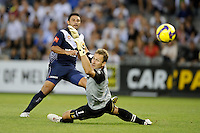 MELBOURNE, AUSTRALIA - FEBRUARY 18, 2010: Carlos Hernandez from Melbourne Victory kicking his goal in the first leg of the A-League Major Semi Final match between the Melbourne Victory and Sydney FC at Etihad Stadium on February 18, 2010 in Melbourne, Australia. Photo Sydney Low www.syd-low.com