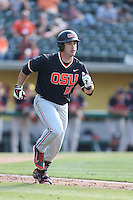 Dylan Davis #10 of the Oregon State Beavers runs to first base during a game against the Southern California Trojans at Dedeaux Field on May 23, 2014 in Los Angeles, California. Southern California defeated Oregon State, 4-2. (Larry Goren/Four Seam Images)