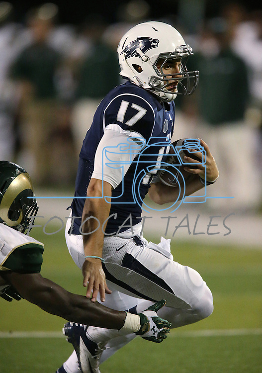 Nevada quarterback Cody Fajardo (17) rushes for a touchdown in second half of an NCAA college football game against Colorado State, in Reno, Nev., on Saturday, Oct. 11, 2014. Colorado State won 31-24. (AP Photo/Cathleen Allison)